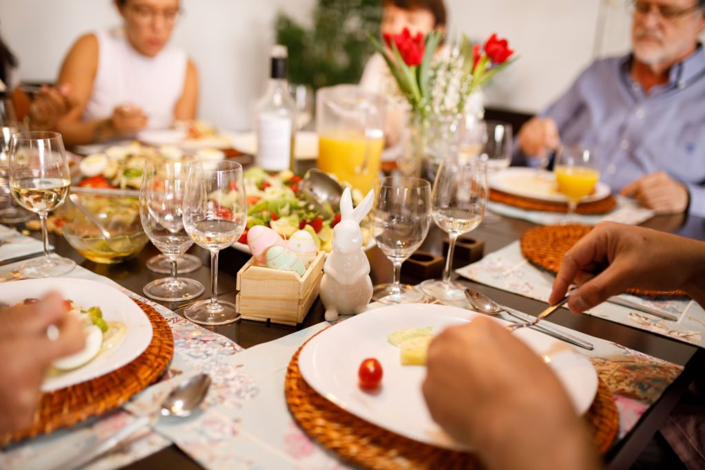 A core family having dinner at home, one way to celebrate Easter safely.